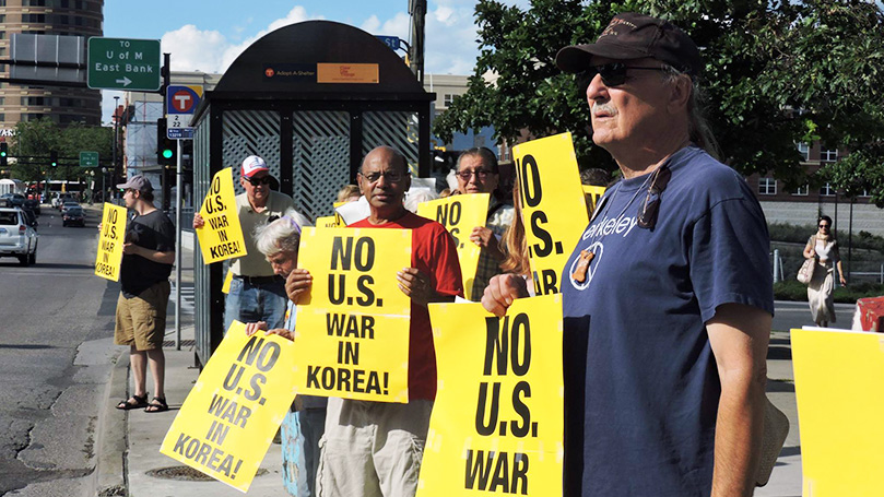 No dangerous saber rattling on Korea! End U.S. intervention!